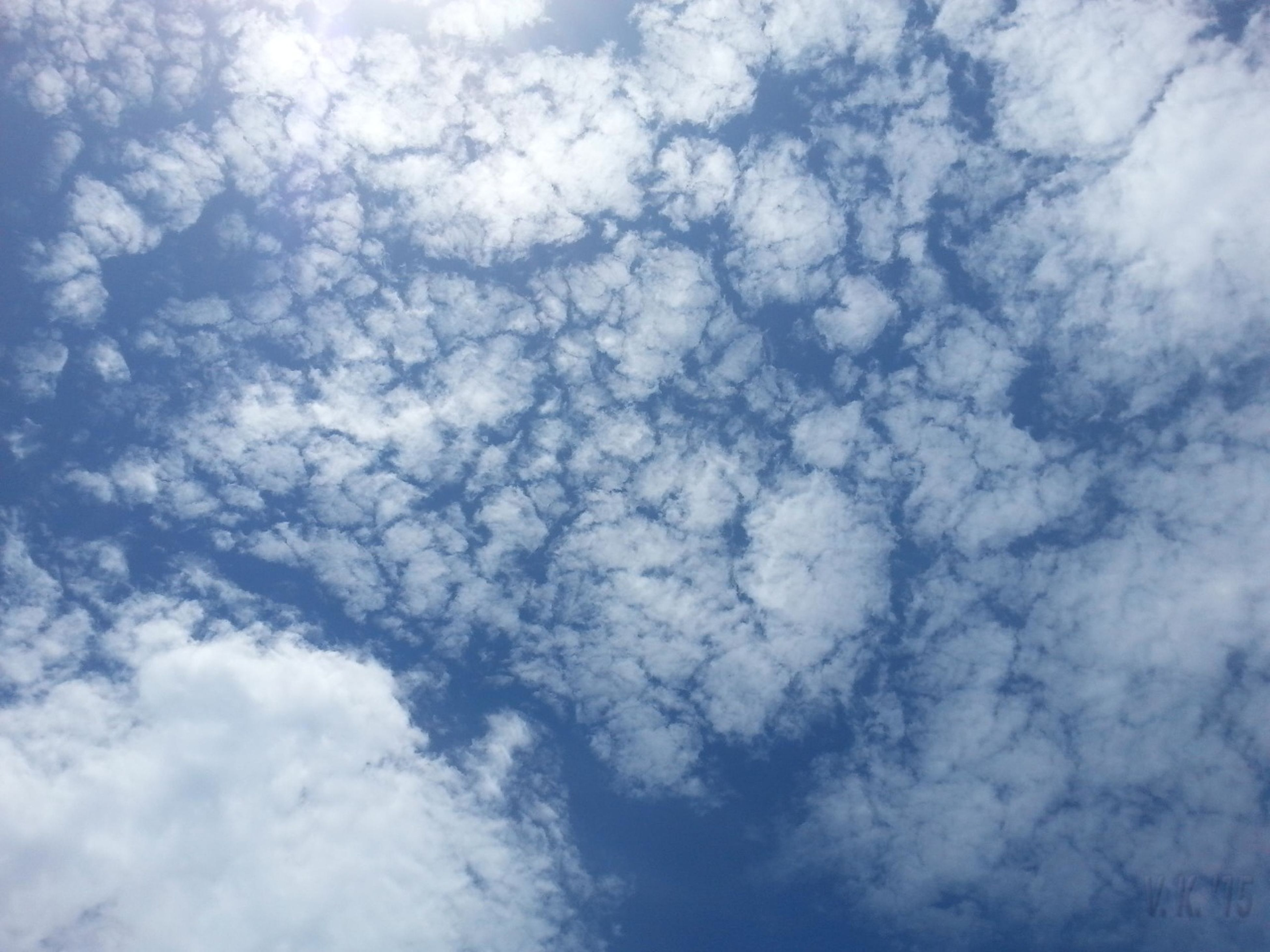 sky, cloud - sky, low angle view, backgrounds, full frame, beauty in nature, tranquility, sky only, cloudy, nature, scenics, tranquil scene, cloudscape, white color, blue, cloud, idyllic, day, weather, outdoors