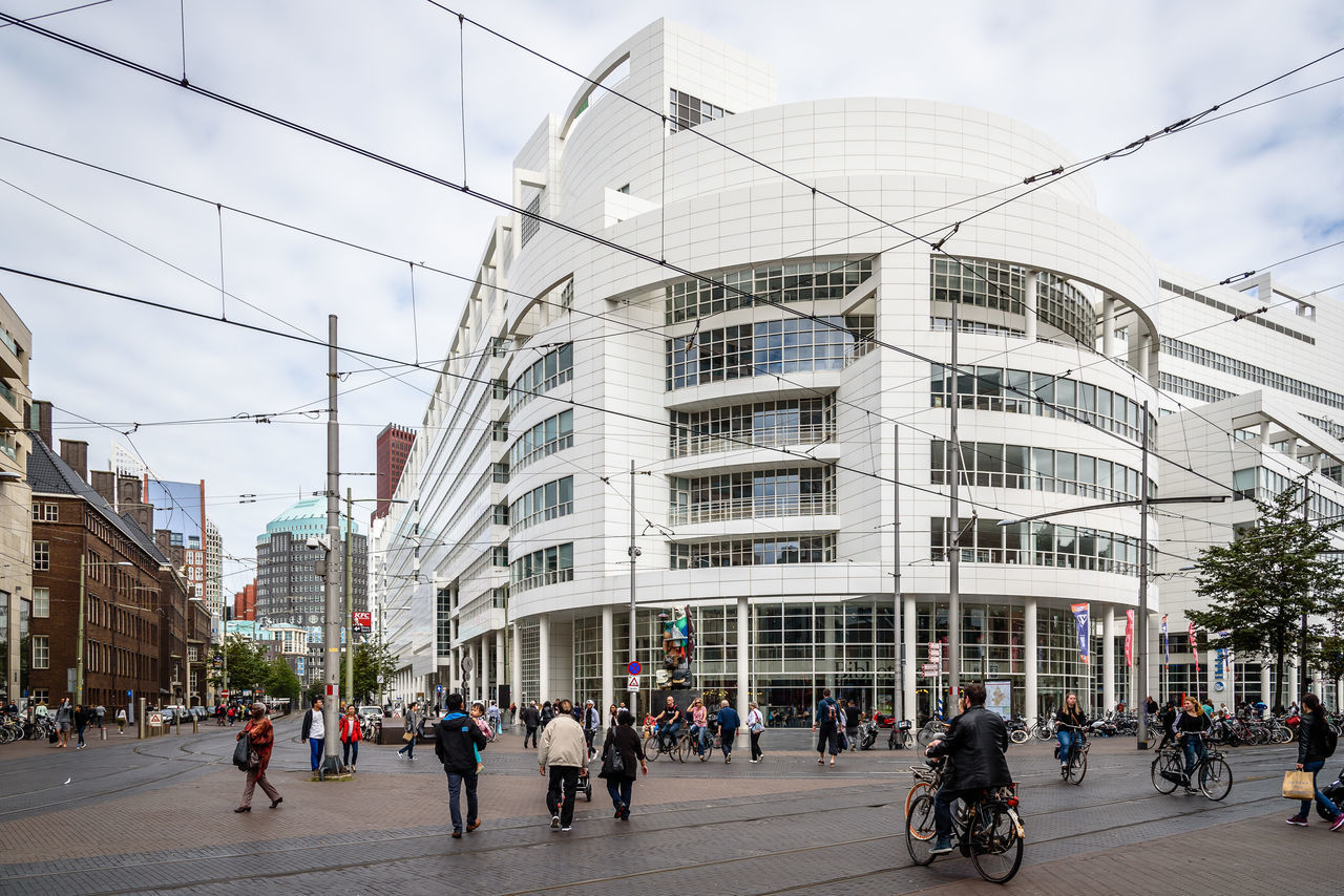 Town hall of The Hague Adult Architecture Building Exterior Built Structure City City City Life Cityscape Day Design Iconic Iconic Buildings Large Group Of People Men Modern Outdoors People Real People Richard Meier Sky Skyscraper The Hague Travel Travel Destinations Women