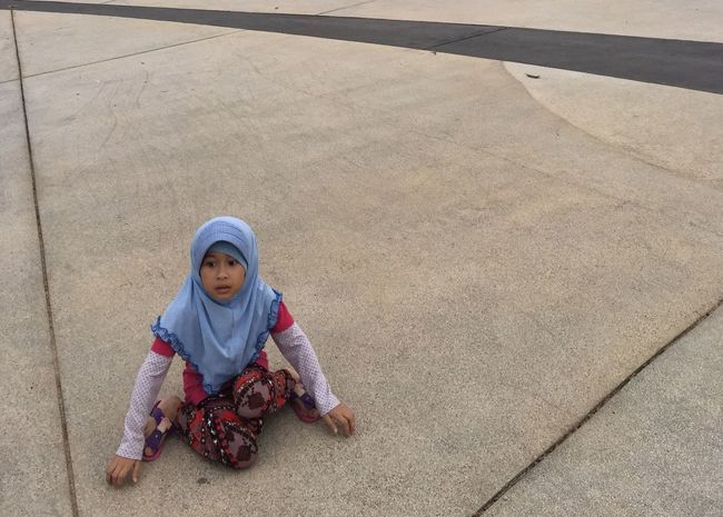 I'm tired Full Length Childhood Portrait Looking At Camera Lifestyles Leisure Activity Sitting Person Cute Casual Clothing Innocence Relaxation Elementary Age High Angle View Day Front View Crouching Carefree Cross-legged Toddler  TakeoverContrast
