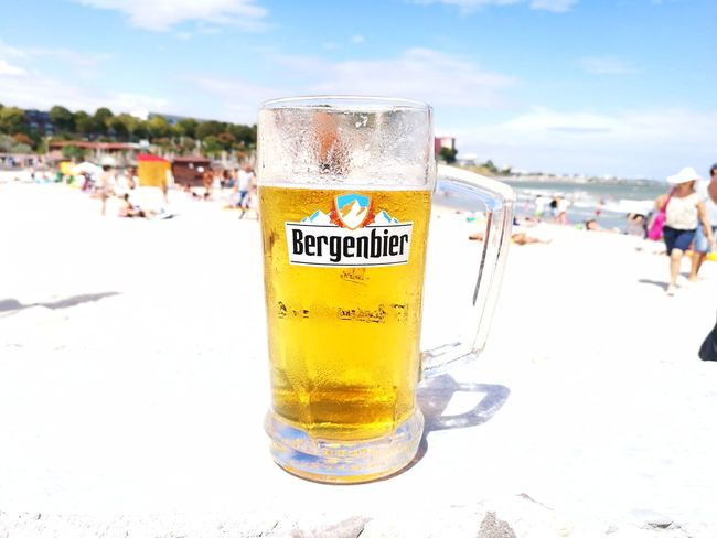 Seaside and a beer , a dream ! People And Places Beach Vacations Sky Shore Incidental People Beachtime Beer - Alcohol Beer Drinking Draught Fresh On Eyeem