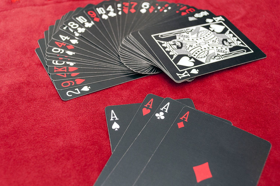 Playing Cards Aces On Table Card Games Cards Casino Close-up Deck Gambling Gambling Hand Luck Magic No People Poker Poker - Card Game Red Shuffle Trick