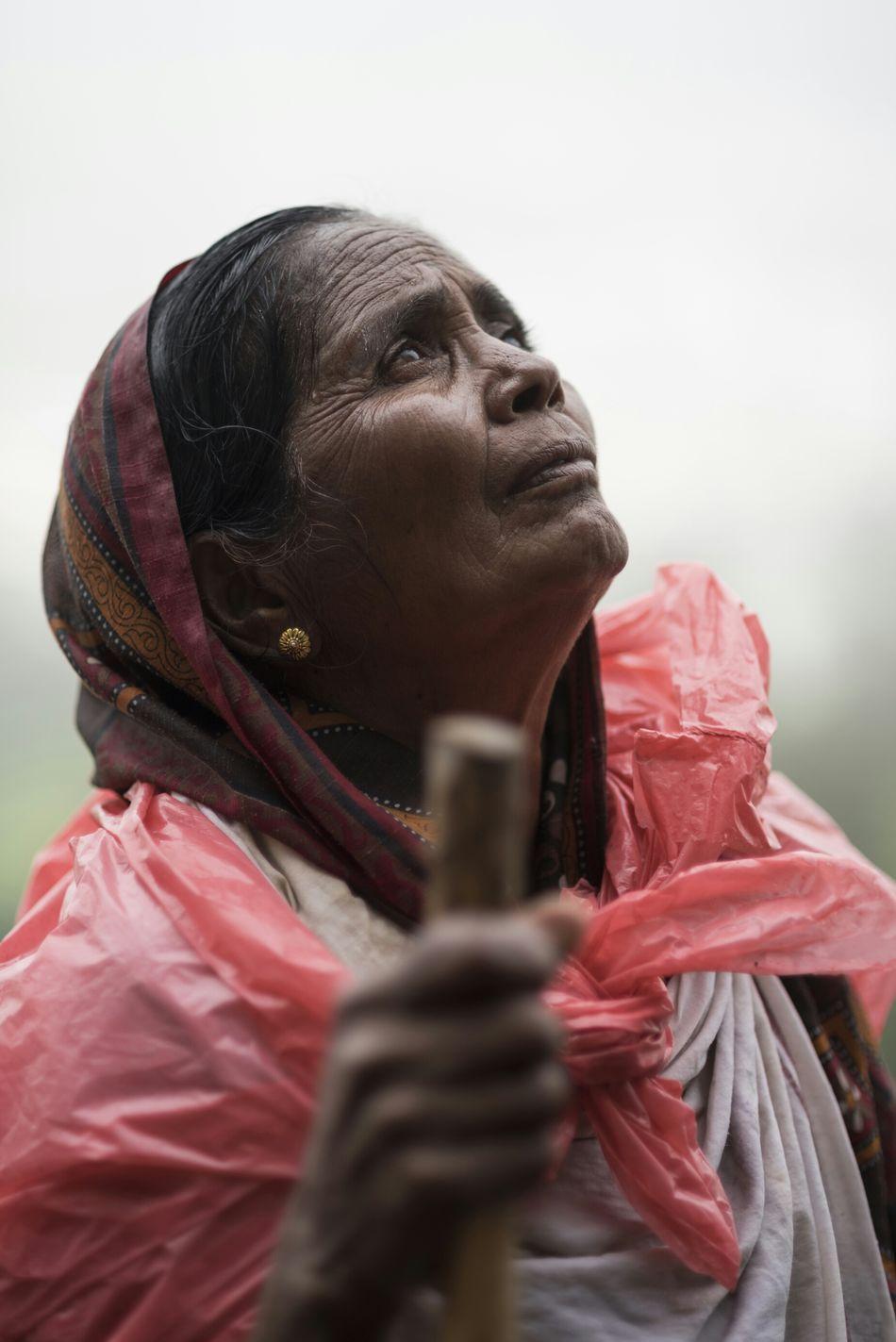 A devotee at Ganga Dwar, Trimbakeshwar. Showcase: December Nashik Trimbakeshwar Kumbhmela People Old Woman India Prayer Rain Waiting The Portraitist - 2016 EyeEm Awards