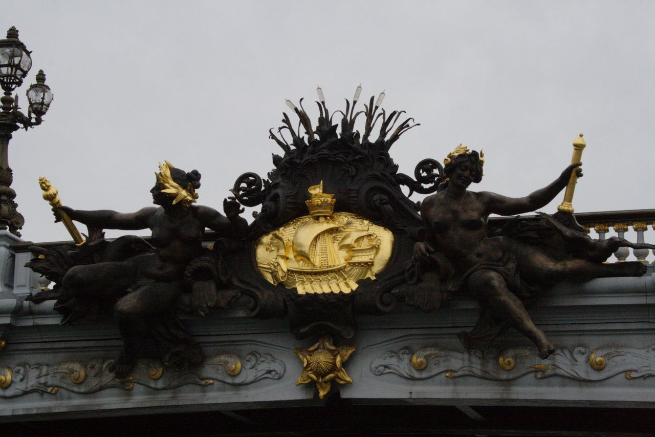 Architecture Crown Day Details Gold Colored No People Outdoors Sculpture Shield Sky Statue