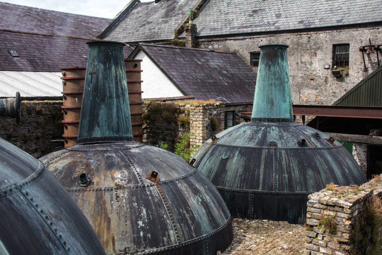 Potstills at Kilbeggan Distillery Agriculture Architecture Building Exterior Built Structure Business Finance And Industry Close-up Day Distillery Kilbegandistillery Kilbeggan No People Outdoors Peat Pot Still Sky Watermill Whiskey Whisky
