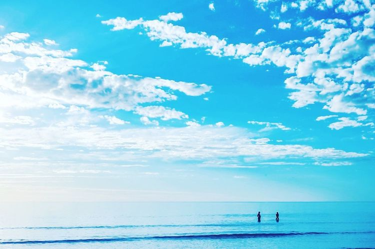 Sea Sky Water Scenics Beauty In Nature Horizon Over Water Nature Tranquil Scene Cloud - Sky Day Tranquility Blue Beach Real People Outdoors Leisure Activity Standing Men Vacations One Person
