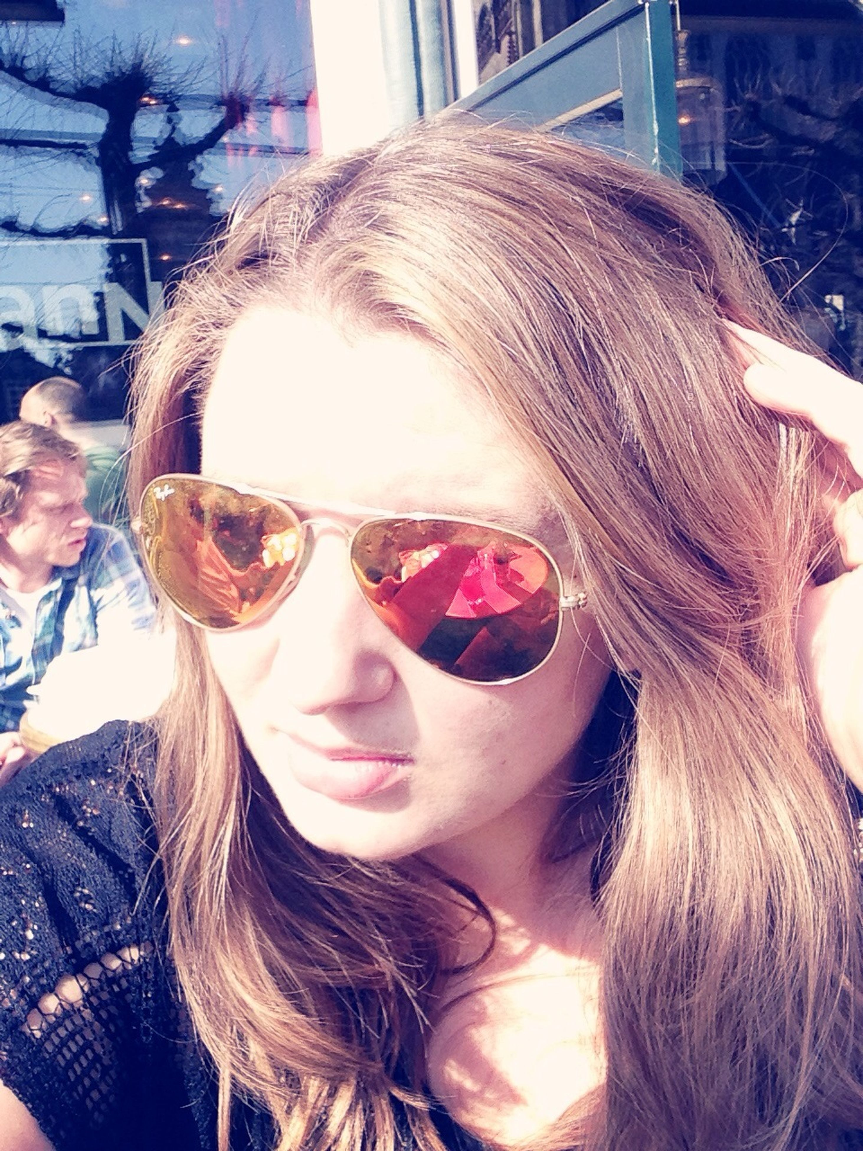 person, headshot, lifestyles, young adult, young women, portrait, leisure activity, looking at camera, long hair, smiling, head and shoulders, front view, sunglasses, close-up, blond hair, sunlight, focus on foreground