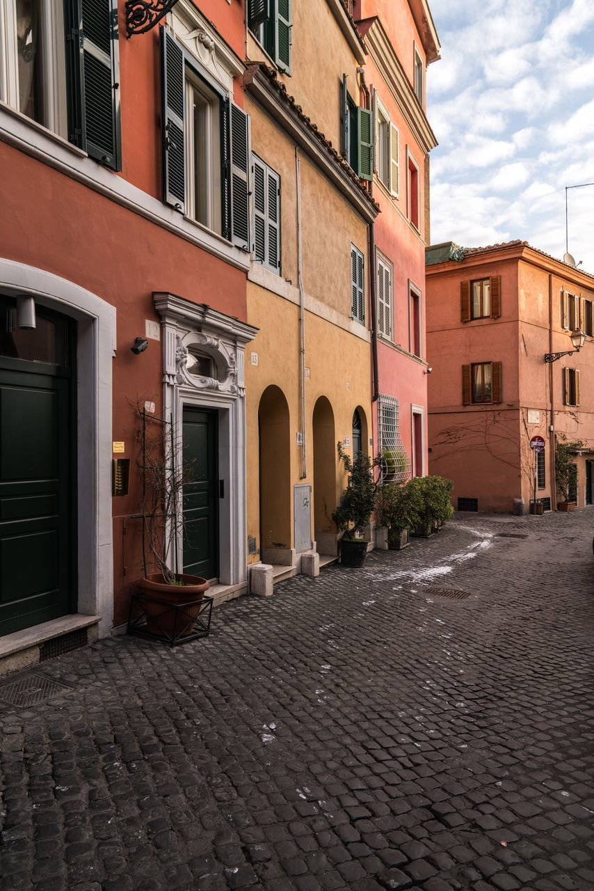 building exterior, architecture, cobblestone, window, built structure, house, outdoors, residential building, sky, no people, city, day