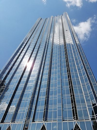 Awesome picture of a sky scraper Tall Tall - High Skyscraper Low Angle View Outdoors Geometric Shape Office Building Sun Cloud - Sky Bright Modern Blue Sky Tower Day Cloud High Section Growth Development Repetition City