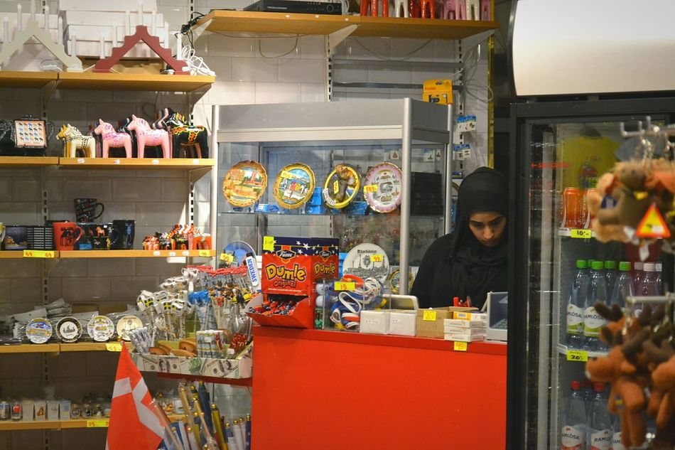 Stall Duty Free Shop Duty Free Shop Airoport Hidjab Woman Lady Woman In Black Woman In Business Working Work Souvenir Souvenirs Souvenir Shop Toy Red Indoors  Toys Candy Candies Counter Sweden Stockholm First Eyeem Photo
