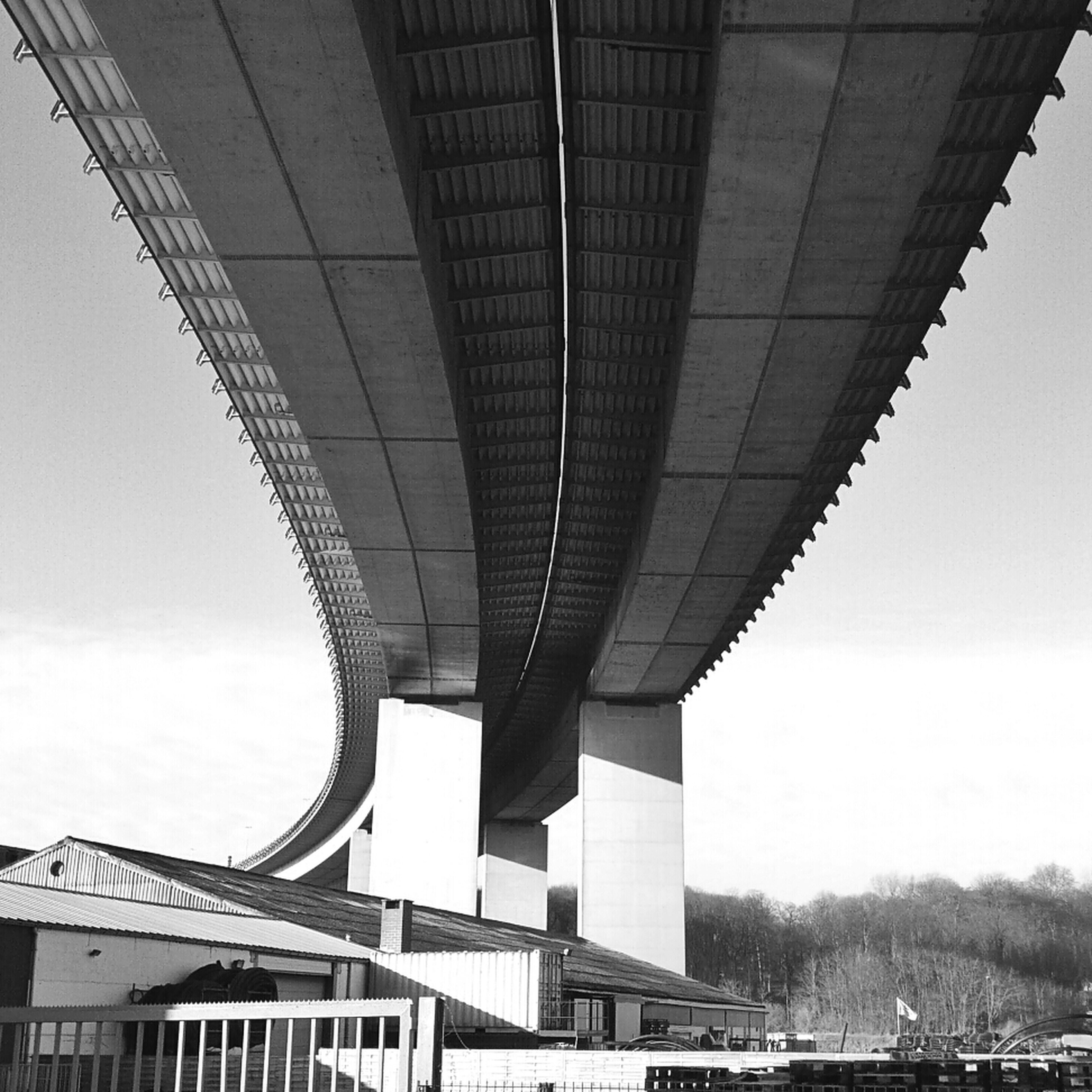 architecture, built structure, building exterior, connection, bridge - man made structure, city, low angle view, modern, engineering, sky, transportation, bridge, skyscraper, office building, day, building, outdoors, no people, river, tall - high