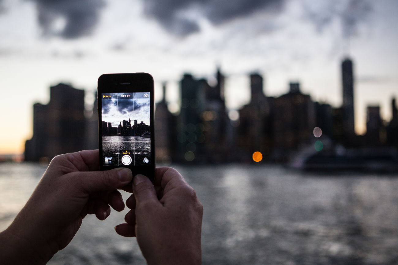 Capturing Manhattan Architecture Camera City Cityscape Clouds Communication Holding Human Hand Manhattan New York NYC Photographing Sky Sky And Clouds Skyline Smart Phone Sunset Taking Photos Technology