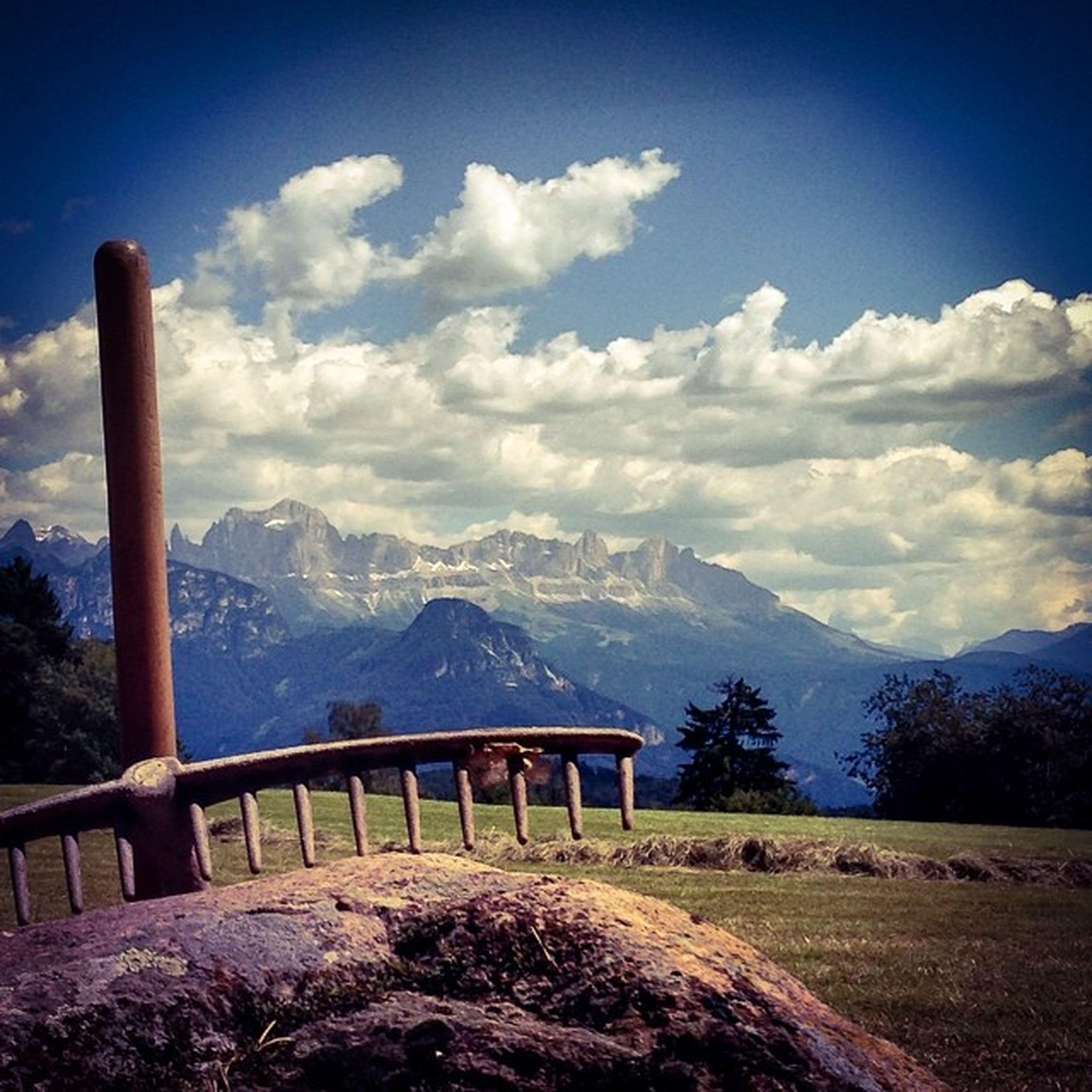 mountain, mountain range, tranquil scene, sky, tranquility, landscape, scenics, beauty in nature, nature, cloud - sky, cloud, non-urban scene, tree, idyllic, snow, day, field, winter, sunlight, remote