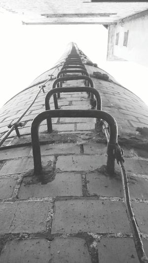Climb Up! Climbing Chimney Smokestack Low Angle View High Clambering Ladder Ladder In Sky Ladder To Nowhere Laddertoheaven Leaning Tower Leaningtower Danger Brave Vertigo Acrophobia Fearless Challenge