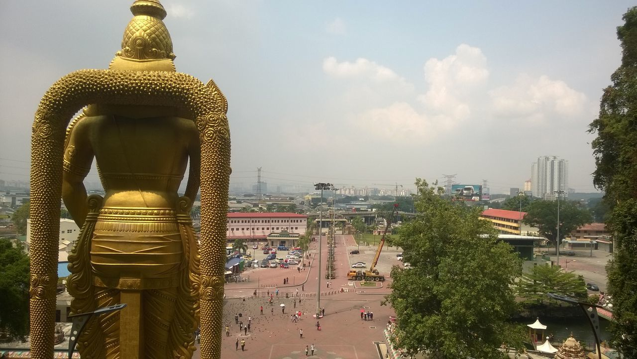 architecture, built structure, building exterior, statue, cityscape, gold colored, outdoors, sky, day, city, no people, tree