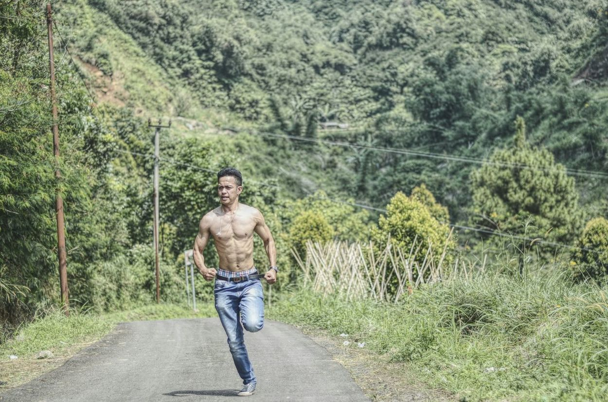Never give up One Person Full Length Casual Clothing One Man Only Only Men Standing Adult Tree Day Walking Adventure Nature Young Adult Real People People Adults Only Road Grass Shirtless Outdoors Nikon D7000 Portrait Friendship Togetherness One Young Man Only