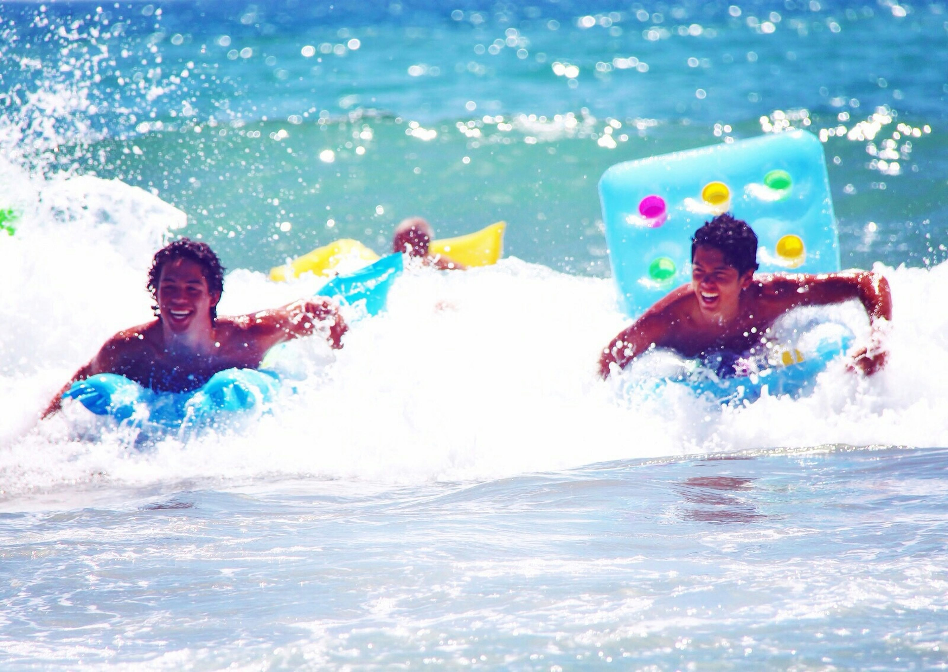 water, leisure activity, lifestyles, sea, enjoyment, vacations, fun, person, togetherness, shirtless, waterfront, childhood, happiness, boys, bonding, summer, elementary age