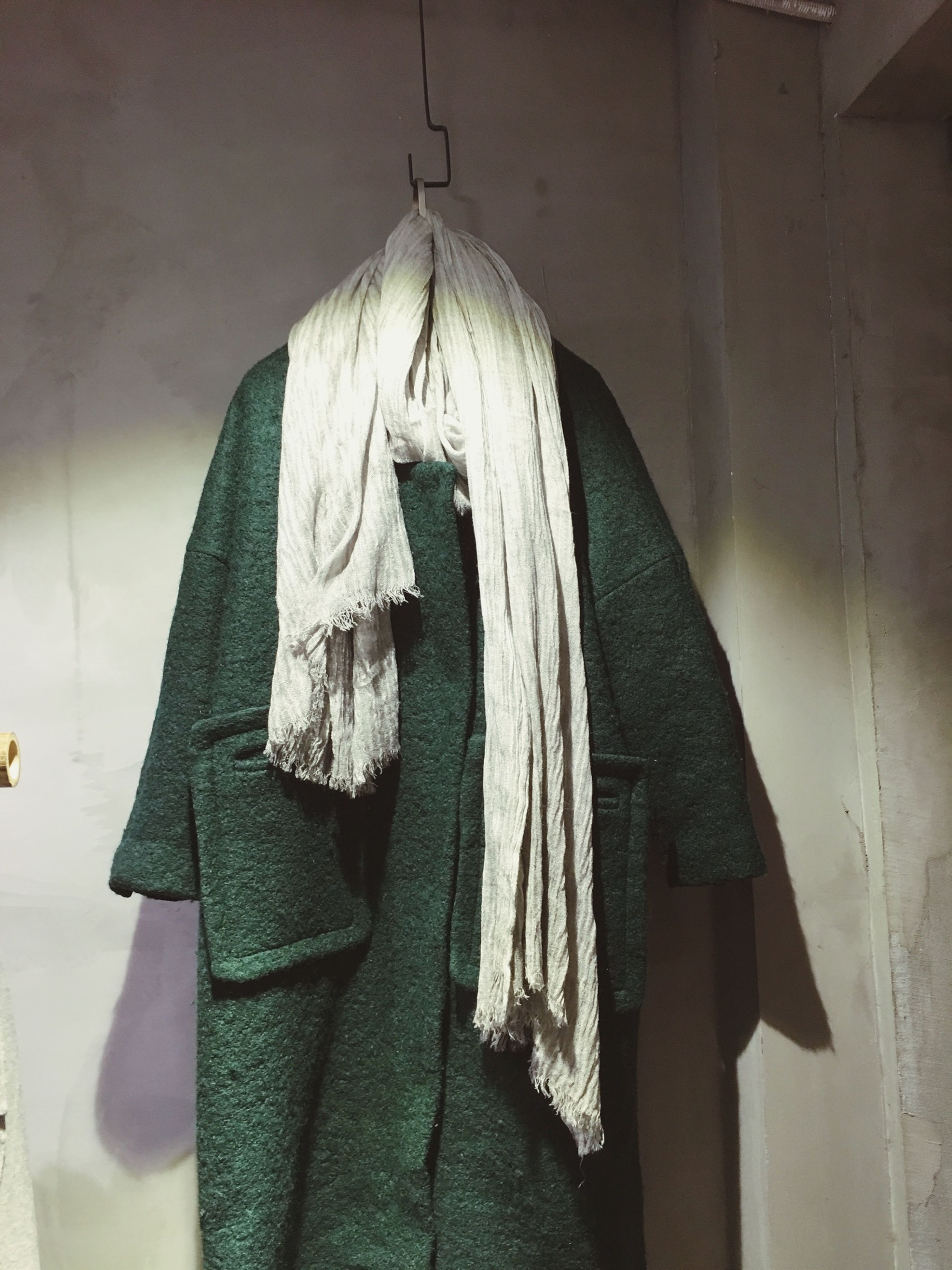 indoors, religion, clothing, fabric, textile, hanging, spirituality, art and craft, place of worship, art, wall - building feature, human representation, creativity, cultures, church, mannequin, day