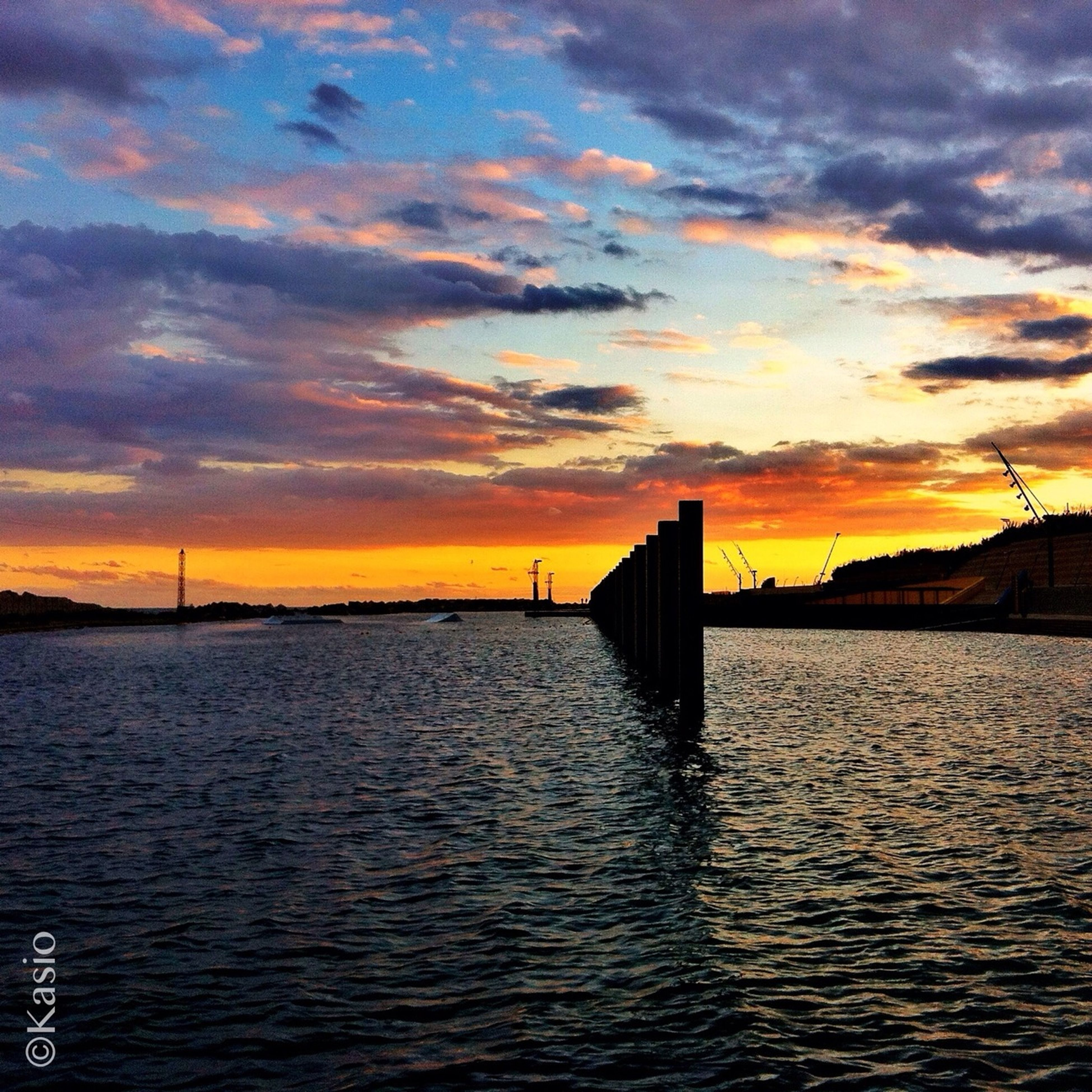sunset, water, sky, orange color, scenics, cloud - sky, sea, beauty in nature, waterfront, tranquil scene, tranquility, built structure, rippled, silhouette, dramatic sky, architecture, idyllic, nature, pier, cloud