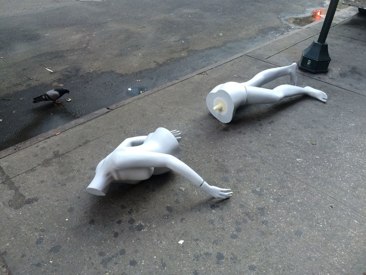High Angle View Of Broken Mannequin On Footpath
