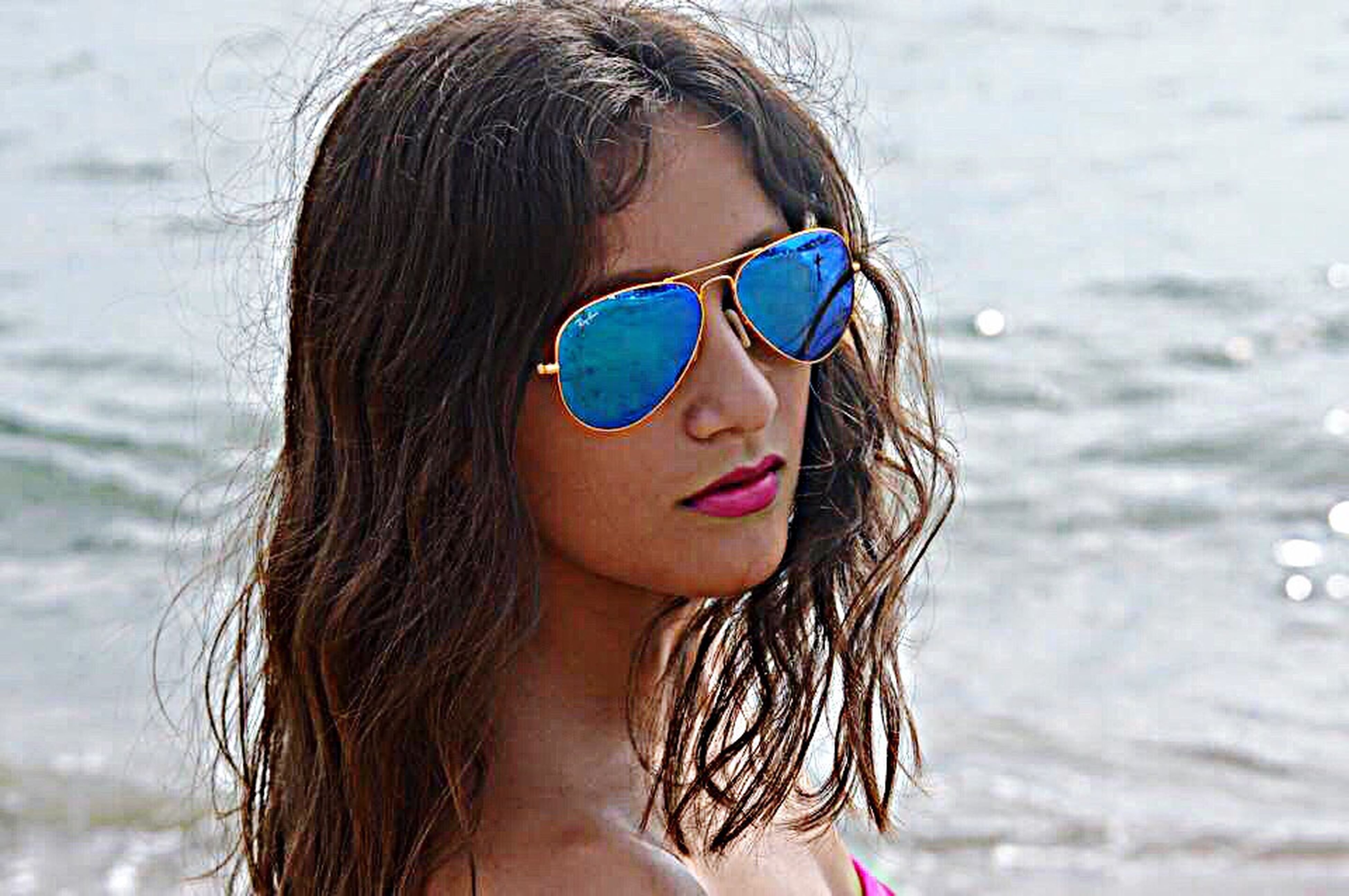 headshot, young adult, focus on foreground, person, lifestyles, long hair, young women, leisure activity, sunglasses, close-up, portrait, front view, looking at camera, head and shoulders, brown hair, blond hair, beauty
