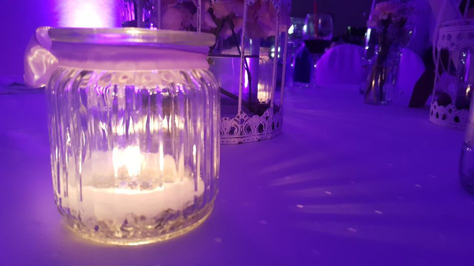 Purple Glass Reflections Candle Light Illuminated Night Lighting Equipment Celebration Table Wedding Photography Wedding Day Wedding Decoration Wedding Decor Close-up Indoors  Scenics Card Design Art Is Everywhere Things Around Me Art Photography Focus On Foreground Art Pink Color Fragility Full Frame