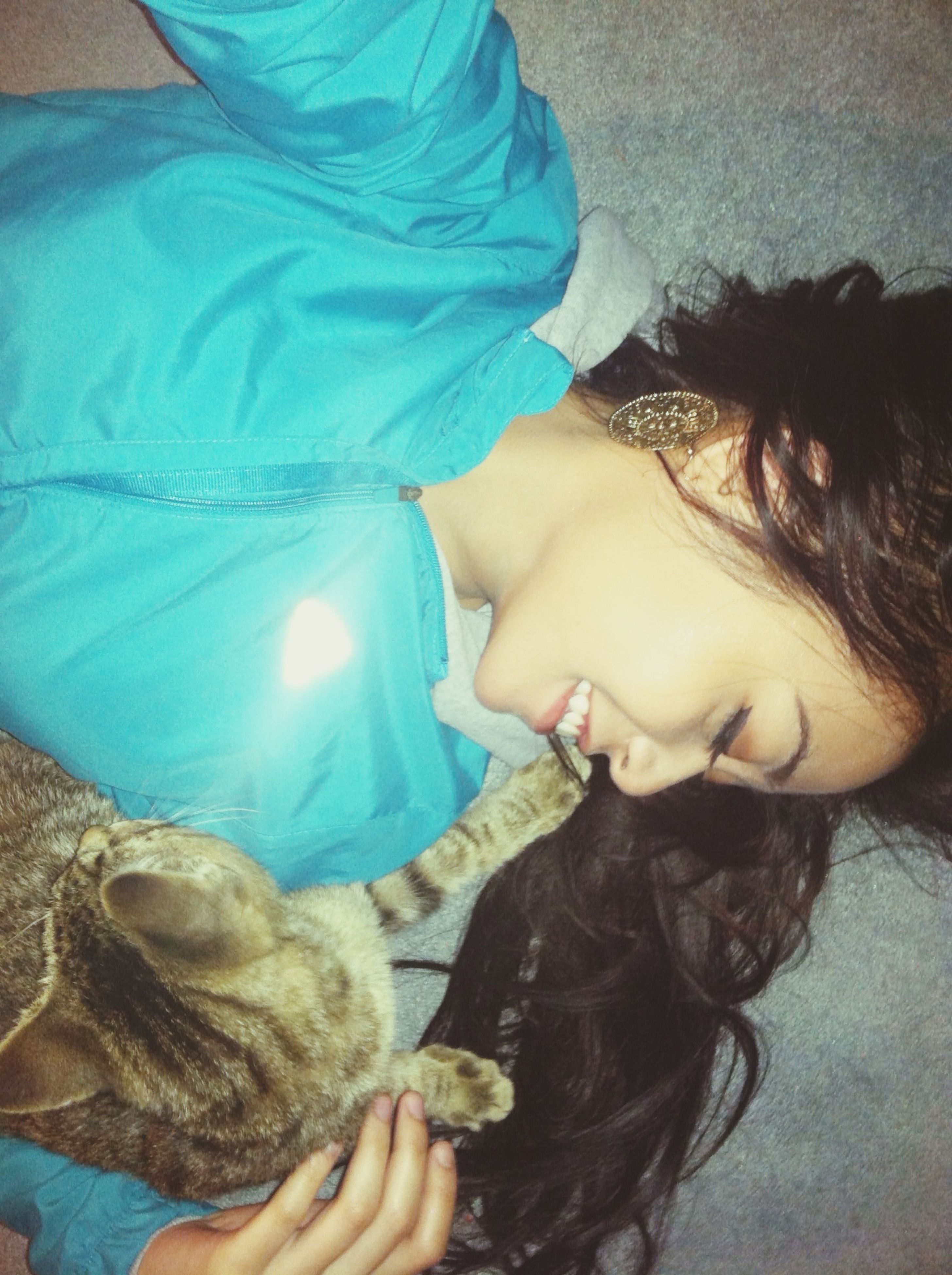 indoors, lifestyles, leisure activity, young women, person, young adult, headshot, high angle view, relaxation, bed, eyes closed, casual clothing, lying down, long hair, close-up, sleeping, childhood