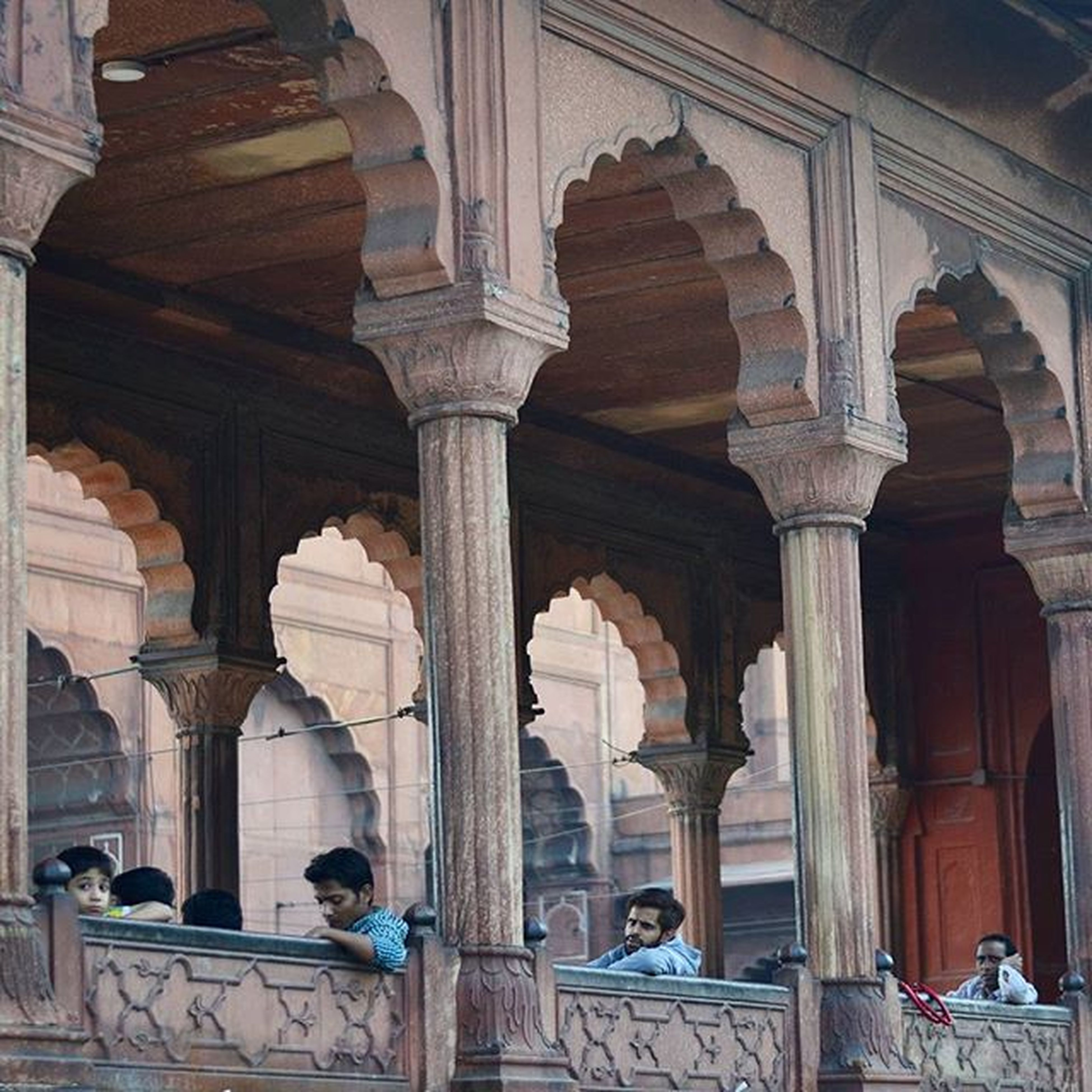 indoors, architecture, built structure, architectural column, arch, men, person, column, chair, ceiling, building exterior, window, sitting, in a row, lifestyles, day, history, interior, travel