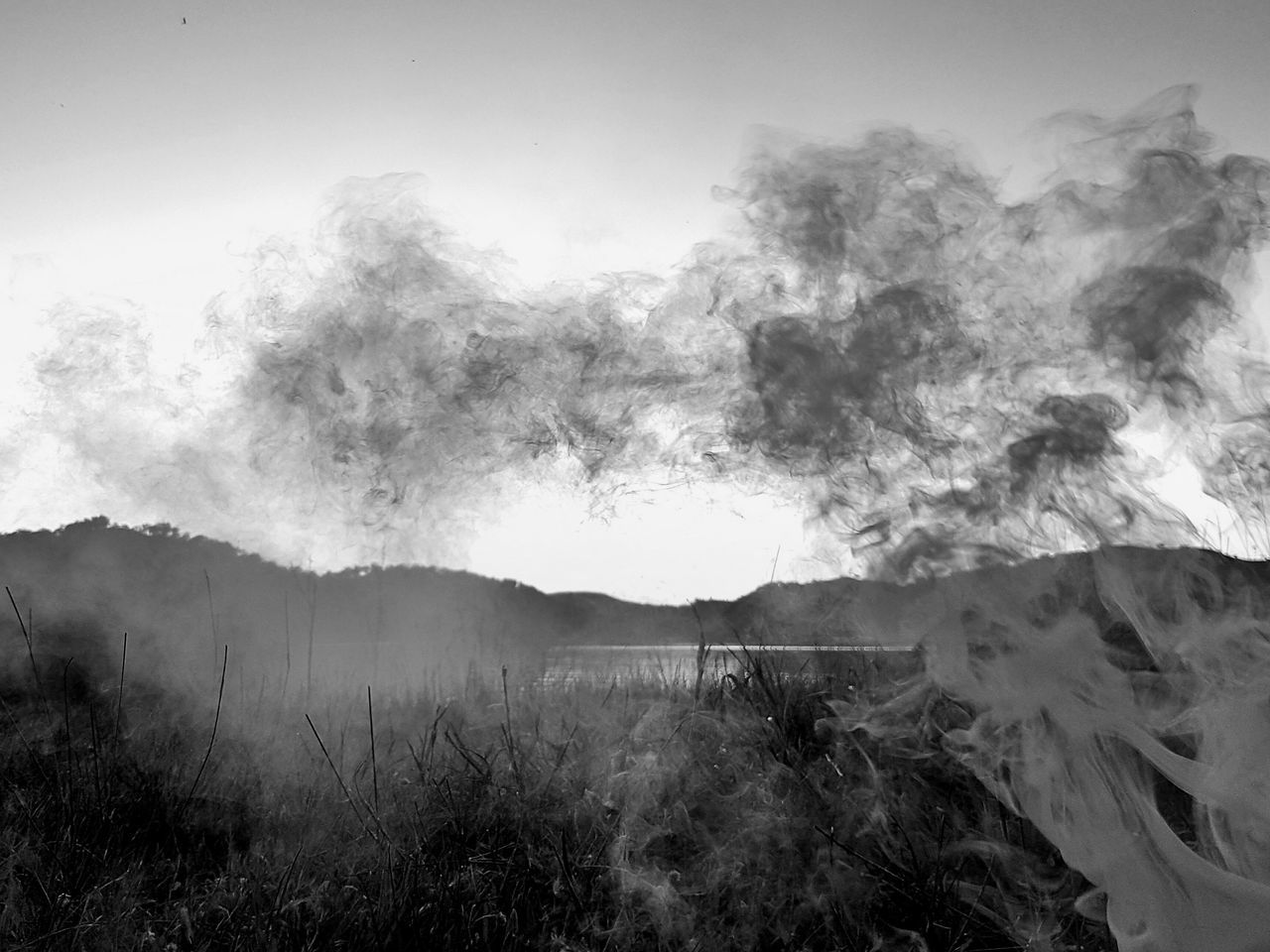 smoke - physical structure, nature, no people, beauty in nature, outdoors, steam, mountain, scenics, day, sky, power in nature, landscape