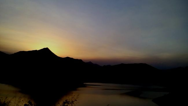 Water Tranquil Scene Tranquility Silhouette Scenics Sunset Mountain Lake Reflection Cloud Sky Waterfront Orange Color Beauty In Nature Dark Nature Non-urban Scene Long Outdoors Solitude LeonEsp  Españoles Y Sus Fotos Telling Stories Differently LeonEsp  Streamzoofamily