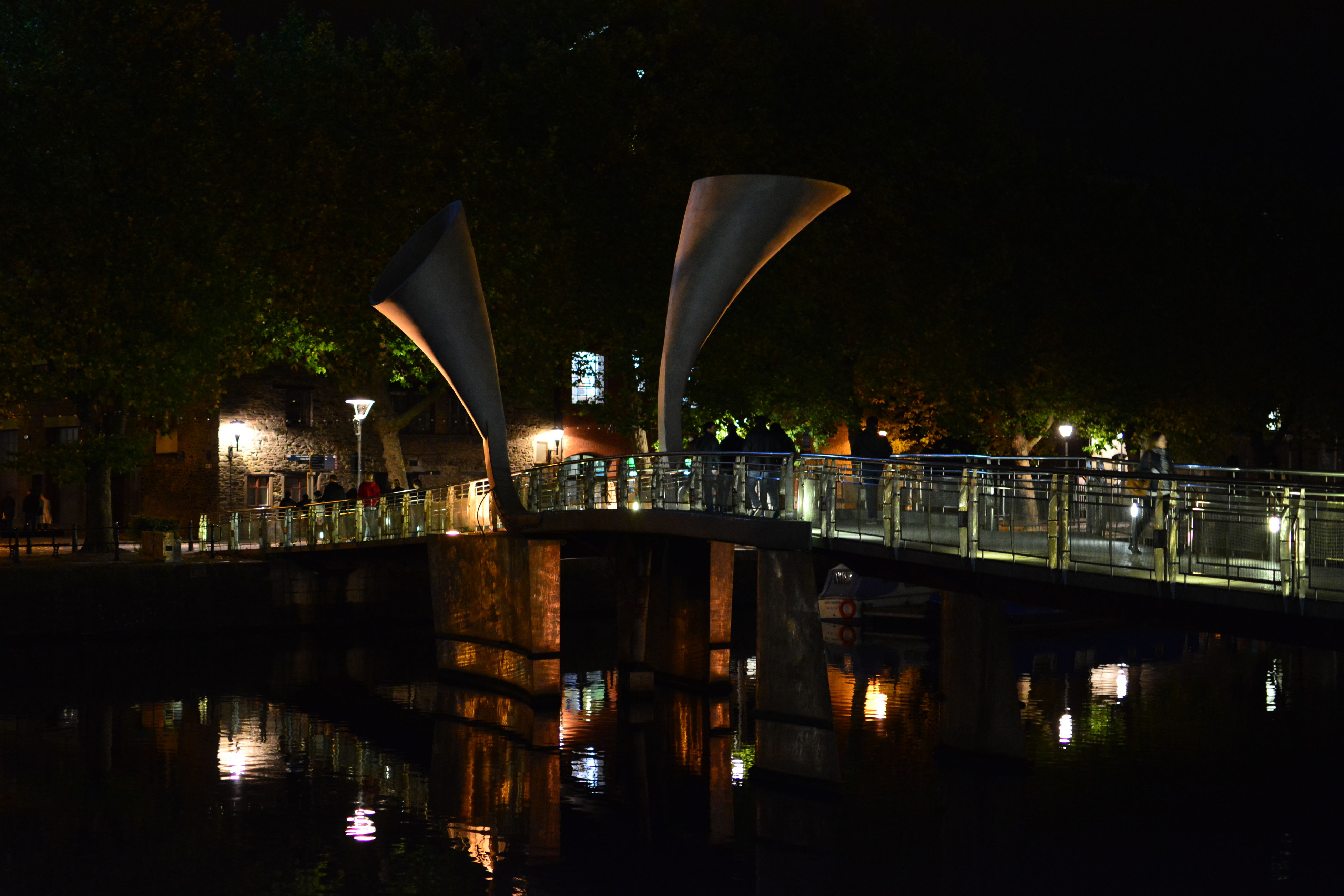 built structure, architecture, water, reflection, night, connection, bridge - man made structure, illuminated, river, waterfront, transportation, clear sky, building exterior, bridge, tree, engineering, canal, outdoors, city, arch bridge