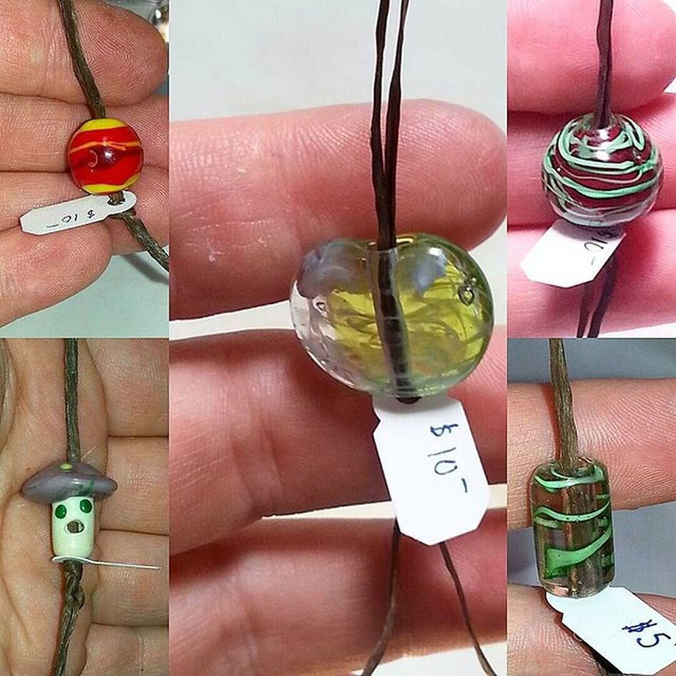 Tiny Saturn, Singing Mushroom, Milky Lentil, Deep Red w/Green Filigree, Clear Barrel with Green Filigree. Getting ready to take them to Market. Nowbeadthis Beads * Handmade Glassbeads * Beading Crafty Craft Crafts * Bead Lampworked Beads Lampwork Glasswork Glassart Artist's Workshop Glass Art Glass Work Artist Workshop Glass Beads Artist's Hands Artists Market Handmade Glass Beads For Sale Hand Made Jewelry Handmade Glass Beads For Sale