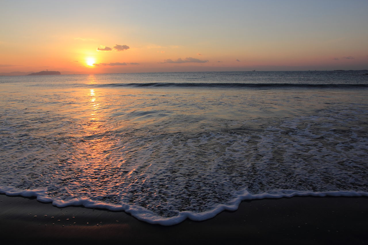 sunset, beauty in nature, water, sea, nature, scenics, tranquility, tranquil scene, sky, sun, idyllic, orange color, beach, horizon over water, reflection, no people, outdoors, day
