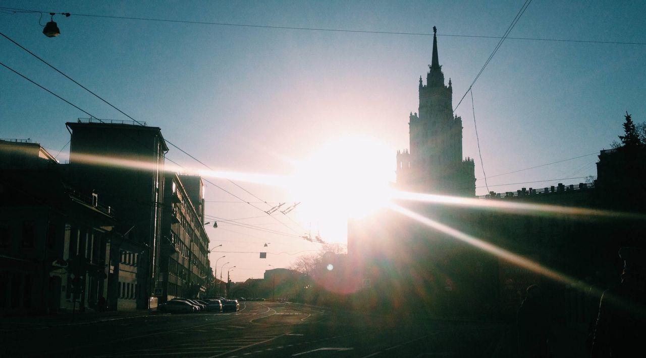 Sun Shining Through City Street
