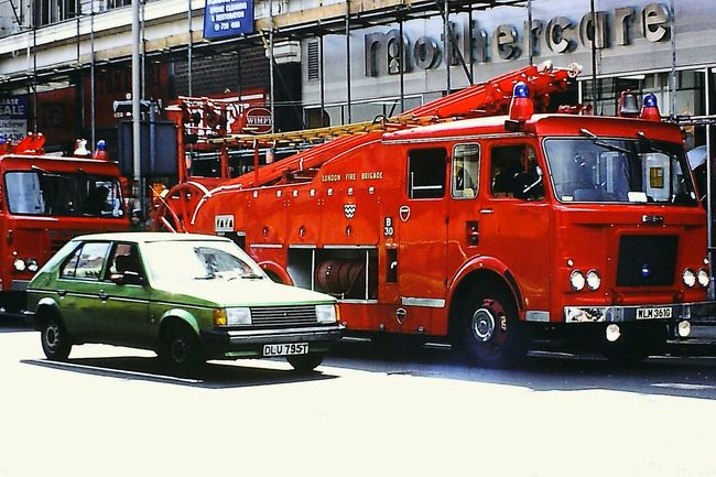 South London, early 1980s, scanned in from a colour transparency Firefighter Fire Engines 1980's  South London Streetphoto_color Streetphotography London Fire Brigade Mothercare Streatham