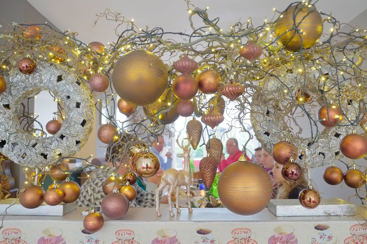 Christmas lunch with the family, photographed through the Christmas decorations. Arrangement Christmas Christmas Around The World Christmas Decorations Christmas Lunch Christmastime Composition Day Decoration Family Full Frame Hanging Organic The Culture Of The Holidays