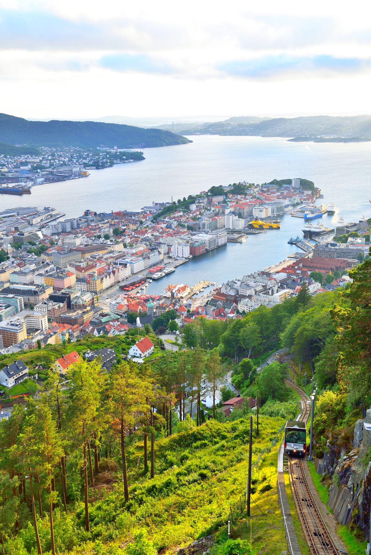 Bergen view from Floyen, cable car tracks. Architecture Bergen Built Structure Business City Cityscape Cloud - Sky Coastline Day Floyen Fløyen Grass Harbor High Angle View Industry Mountain Nautical Vessel Norway Outdoors Sea Sky Summer Transportation Tree Water