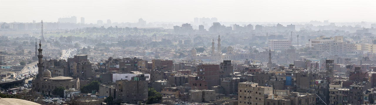 Cairo skyline from the Mokkatam hill Aerial Aerial View Africa Arab Architecture Building Exterior Cairo City City Life Cityscape Day Fog Haze Modern Near East North Africa Outdoors Panorama Panoramic Pollution Smog Travel Destinations Urban Skyline