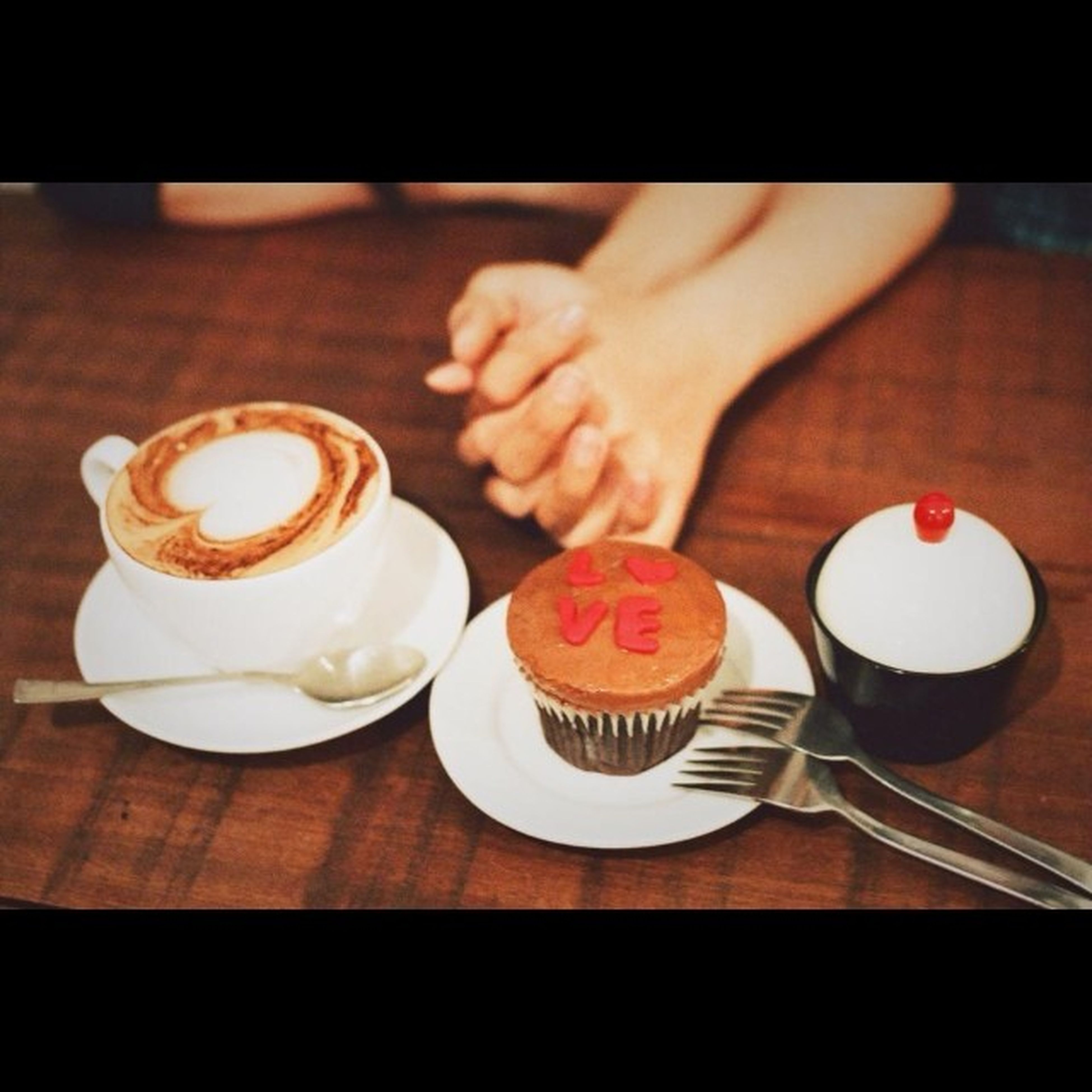 food and drink, coffee cup, drink, indoors, refreshment, table, coffee - drink, saucer, freshness, coffee, cup, cappuccino, frothy drink, still life, froth art, high angle view, spoon, breakfast, close-up, plate