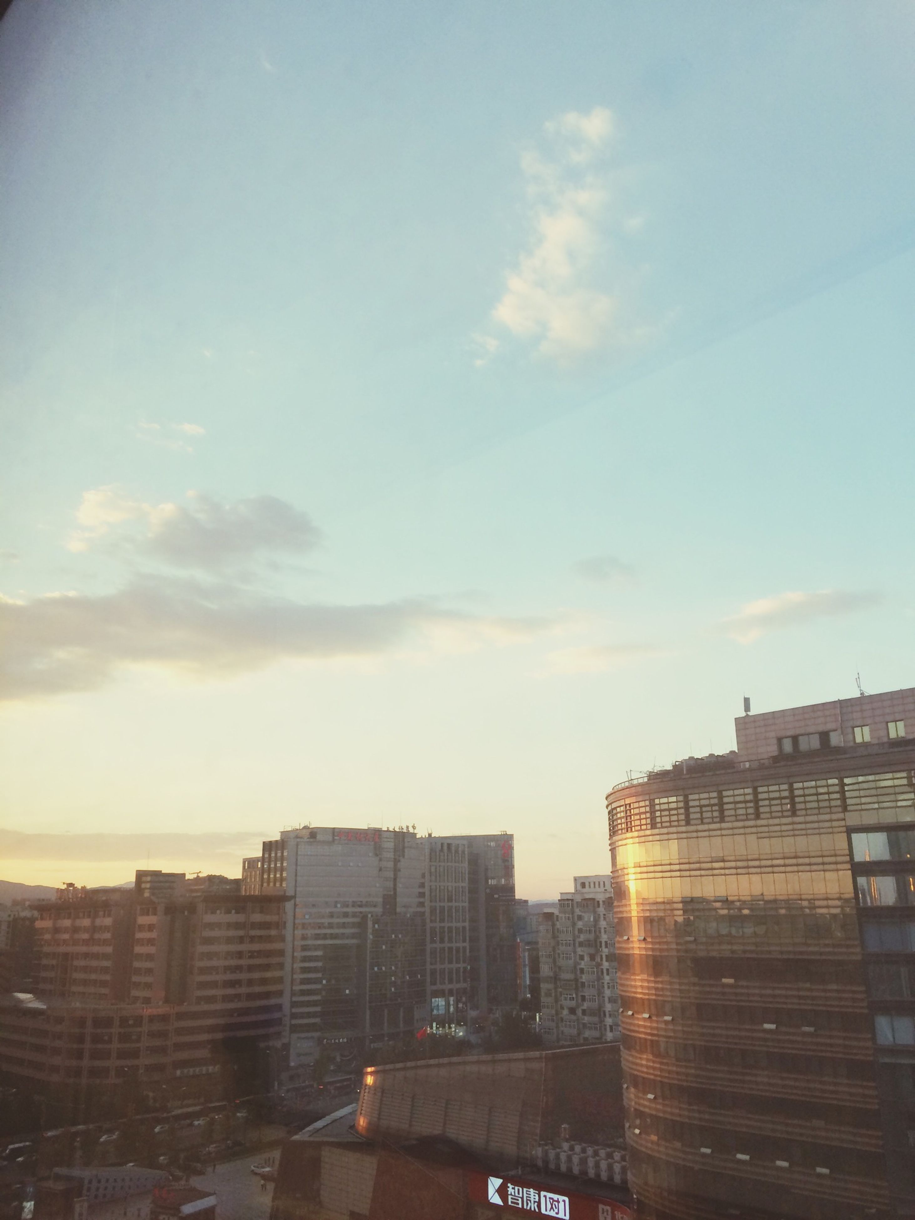 building exterior, architecture, built structure, city, sky, cityscape, residential building, building, sunset, residential structure, cloud - sky, city life, residential district, outdoors, cloud, no people, high angle view, low angle view, sunlight, modern