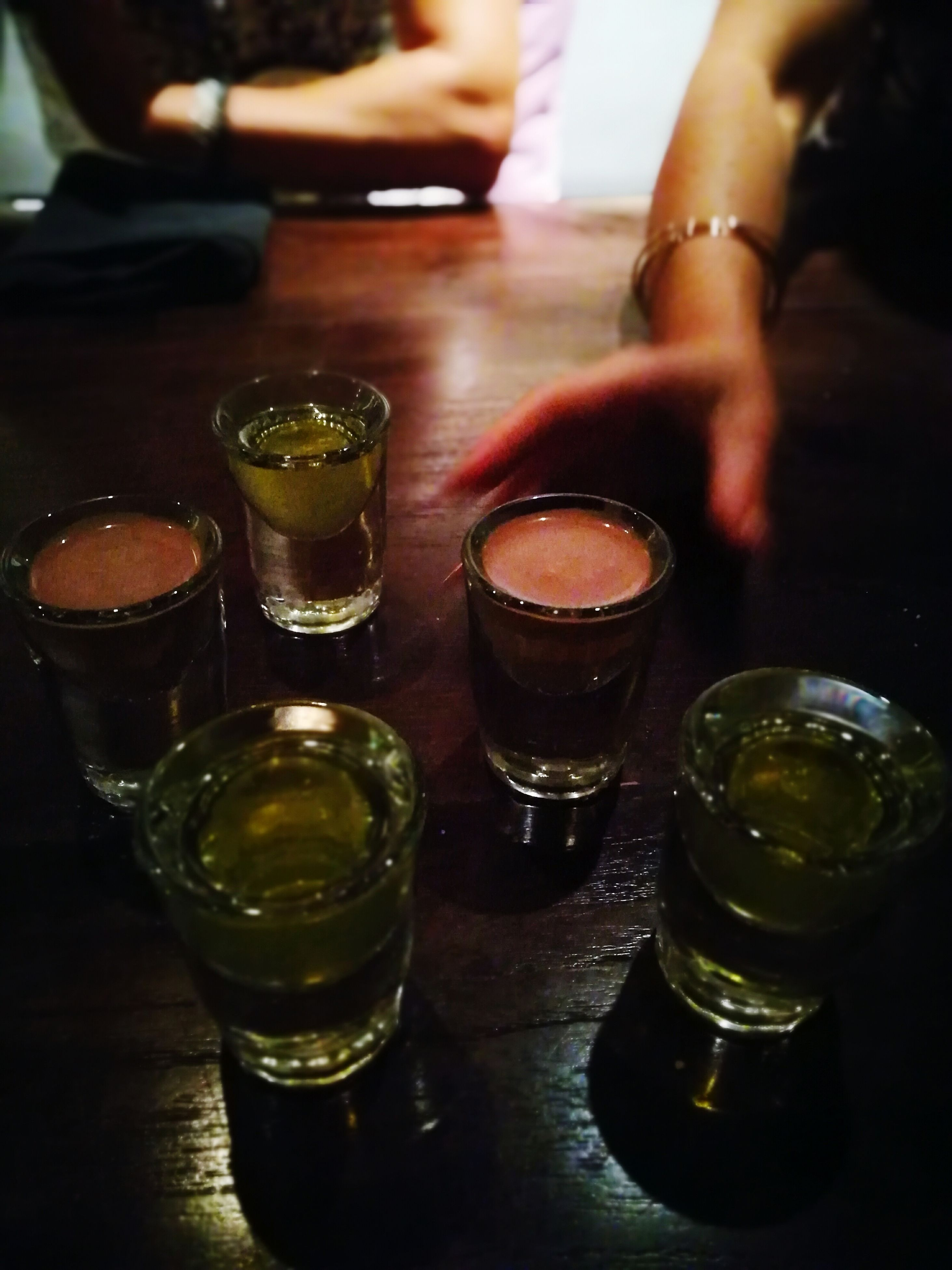 shot glass, drink, food and drink, alcohol, refreshment, table, drinking glass, tequila - drink, whiskey, indoors, bar - drink establishment, freshness, liqueur, happy hour, close-up, no people