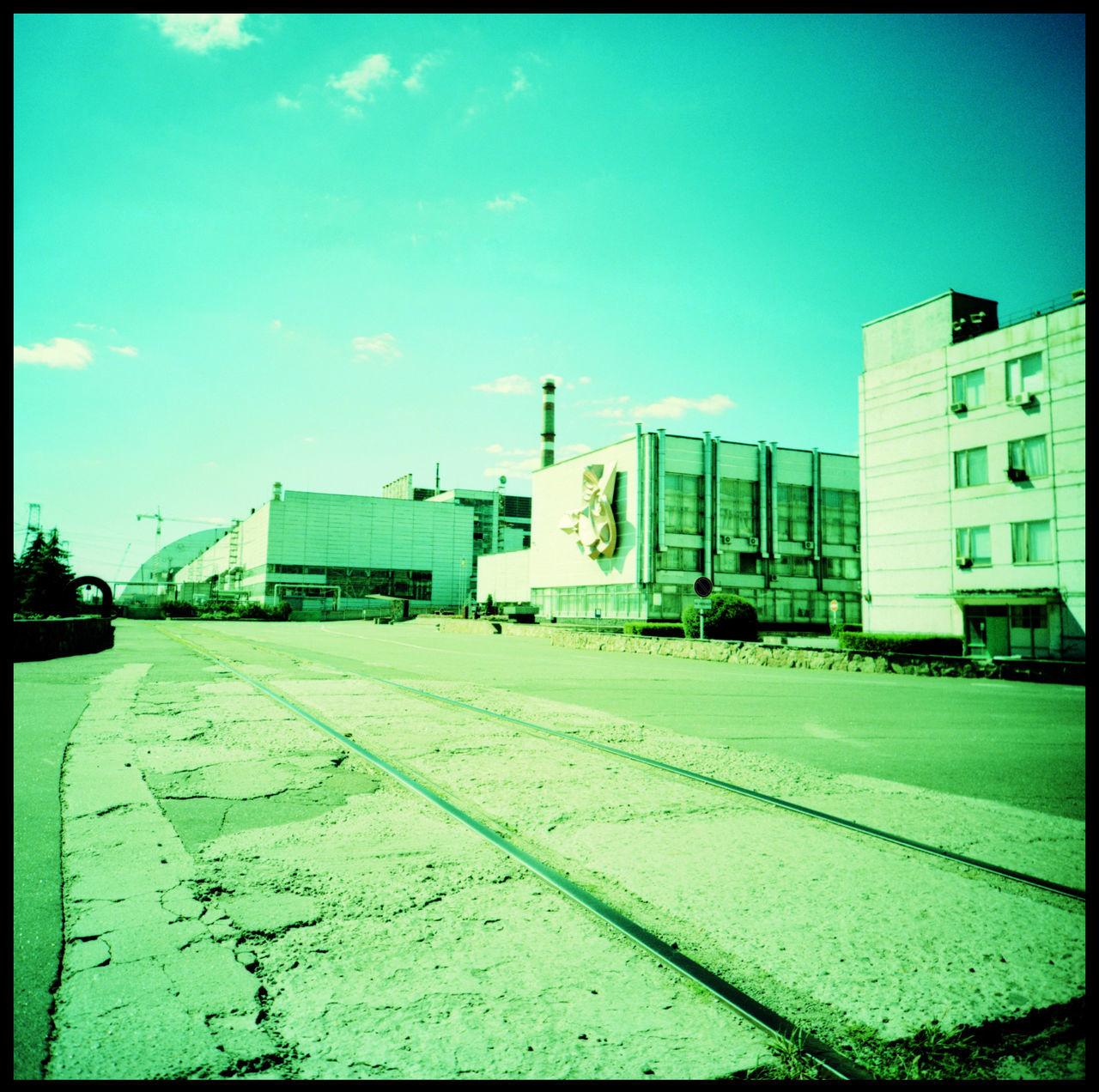 The reactors 1-3 in Chernobyl, still working until this day Analogue Photography Bridge Chernobyl Chernobyl 1986 Chernobyl Bridge Chernobyl Catastrophe Chernobyl Exclusion Zone Chernobyl Monument Chernobyl Nature Chernobyl Nuclear Power Plant Chernobyl Reactor Chernobyl Reactor 1-3 Lomography Nuclear Disaster Nuclear Energy Nuclear Power Plant Architecture Outdoors Power Plant Radioactive Rails Railtracks Soviet Union Travel Ukraine Xpro