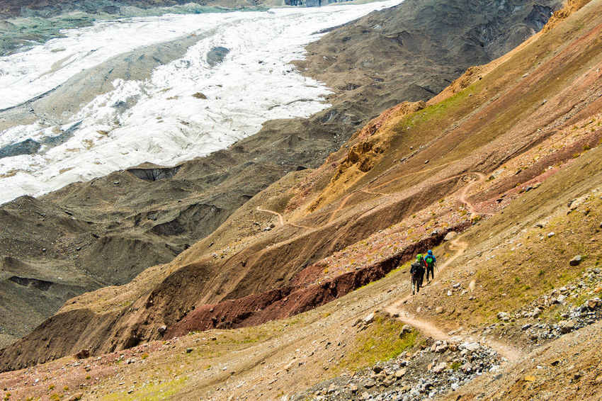 Kyrgyzstan Pamir Mountains Trekking Adventure Beauty In Nature Day Hiking Landscape Leisure Activity Lifestyles Men Mountain Mountain Range Nature Outdoors Pamir People Real People Rock - Object Rocky Mountains Scenics Sport Travel Travel Destinations Vacations