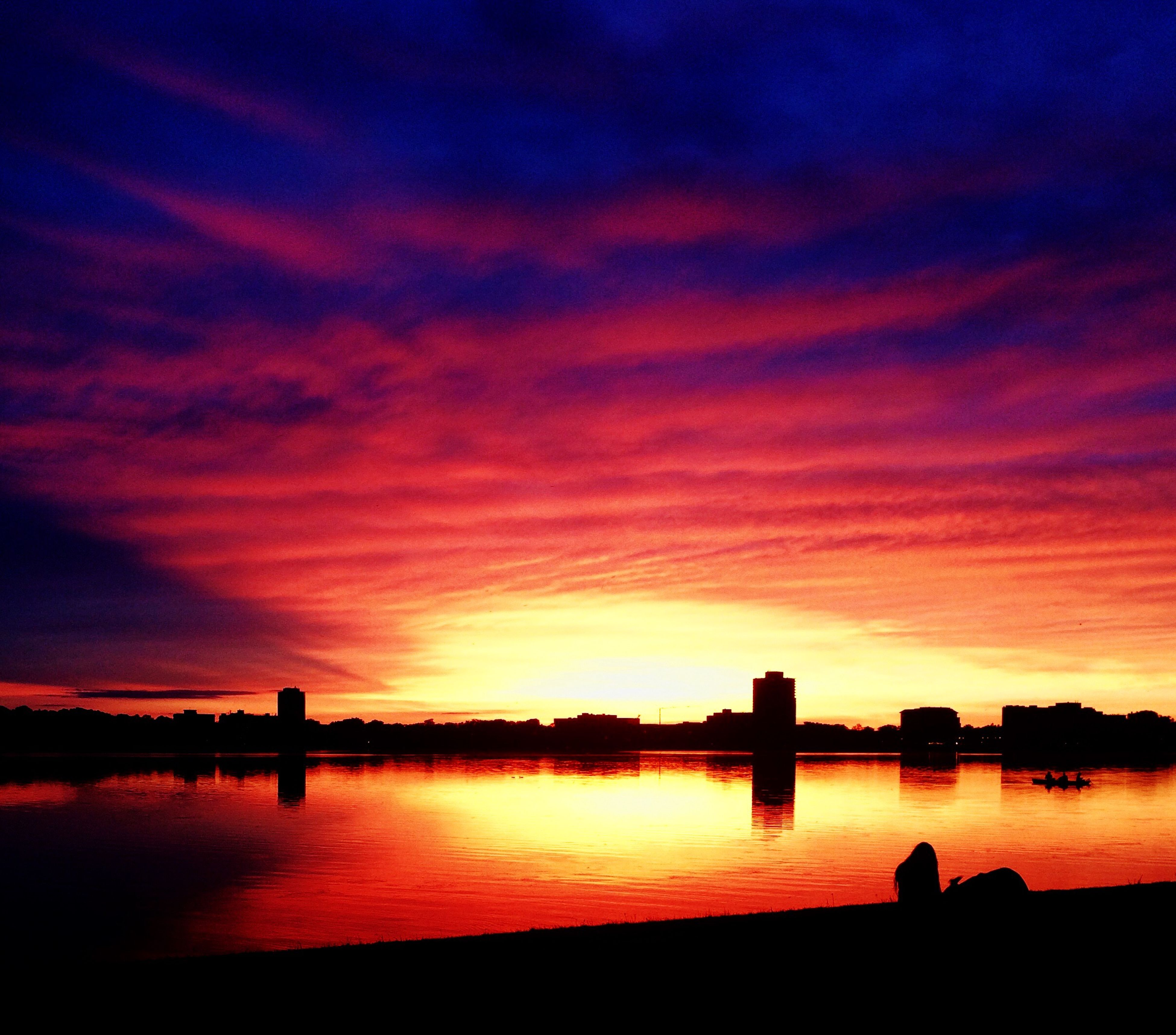 sunset, silhouette, orange color, sky, water, built structure, architecture, scenics, beauty in nature, tranquil scene, building exterior, waterfront, tranquility, dramatic sky, cloud - sky, idyllic, reflection, nature, cloud, lake