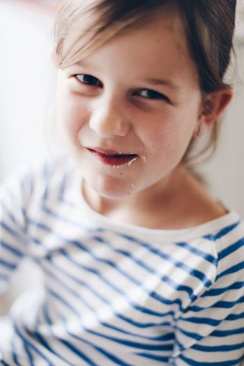 Smiling Striped Happiness Portrait Childhood One Person Looking At Camera Indoors  Close-up Young Adult People Full Frame Indoors  High Angle View Lifestyles Day Eating Messy Face Face Cute Cute Girl Kid Children Only Children's Portraits