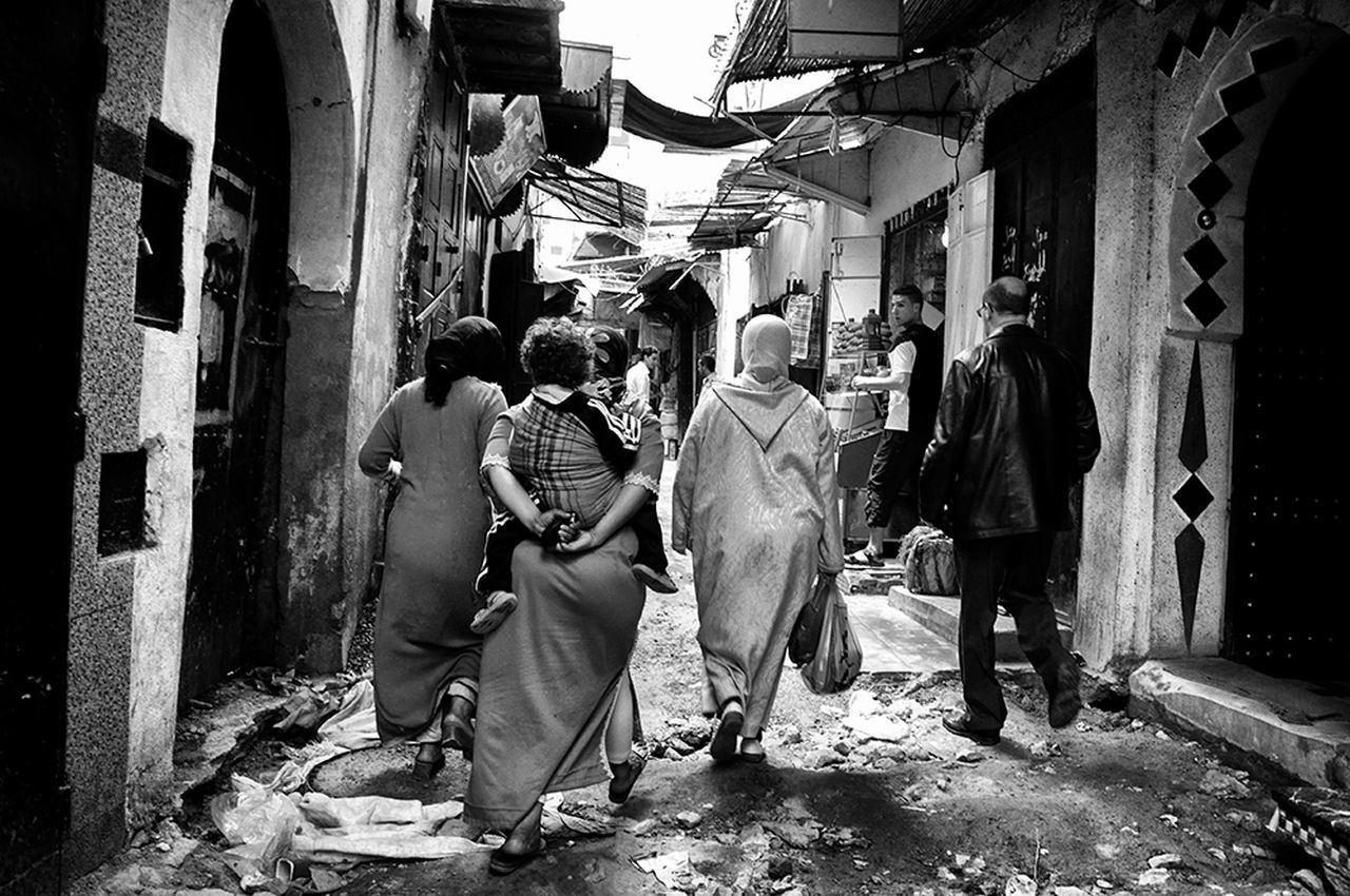 Women Around The World Women Who Inspire You Motherhood Streetphotography Real People Daily Life Blackandwhite Photography Motherhood Moments Large Group Of People Lifestyles Togetherness Women Of EyeEm Woman Power Childhood Localscene Women People - Medina De Fez Fez Morocco Africa
