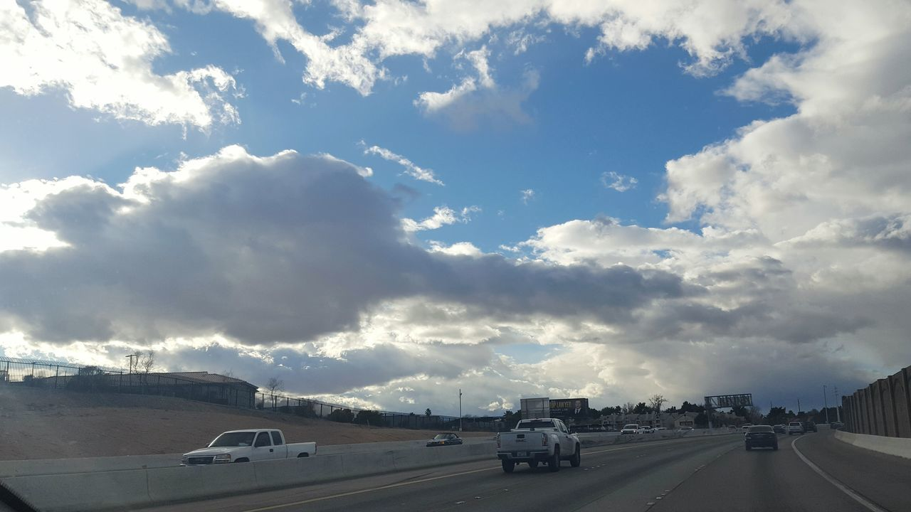 car, transportation, land vehicle, road, cloud - sky, mode of transport, sky, day, the way forward, no people, outdoors, nature