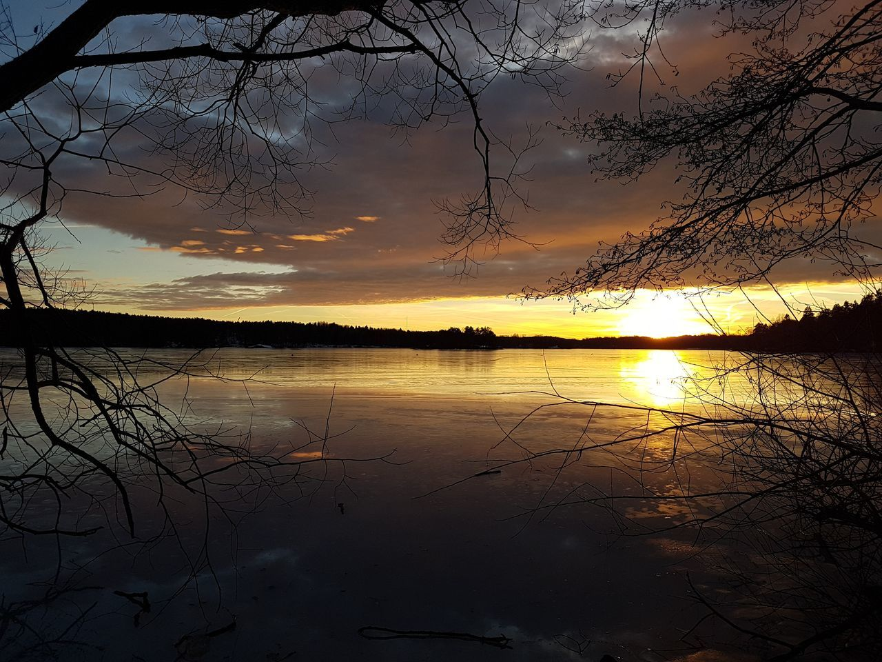 Sunset Reflection Water Sky Nature Beauty In Nature Dramatic Sky Silhouette Tree Scenics Lake Tranquility Outdoors Wet No People Sun Reflection Lake Refraction