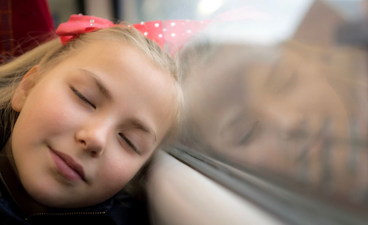 Peaceful One Person Looking At Camera Real People Lifestyles Headshot Portrait Smiling Happiness Blond Hair Indoors  Close-up Leisure Activity Young Adult Home Interior Young Women Childhood Window Reflections Peace And Quiet Peaceful Sleepy Sleeping On Train Reflection Reflections Reflection_collection