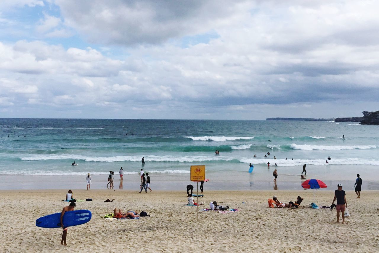 Cloudy Bondi Days. Sea Beach Horizon Over Water Large Group Of People Sand Water Sky Cloud - Sky Scenics Lifestyles Shore Real People Nature Outdoors Beauty In Nature Leisure Activity Vacations Women Tranquil Scene Day Bondi Beach Beachphotography Surf Australia Sydney