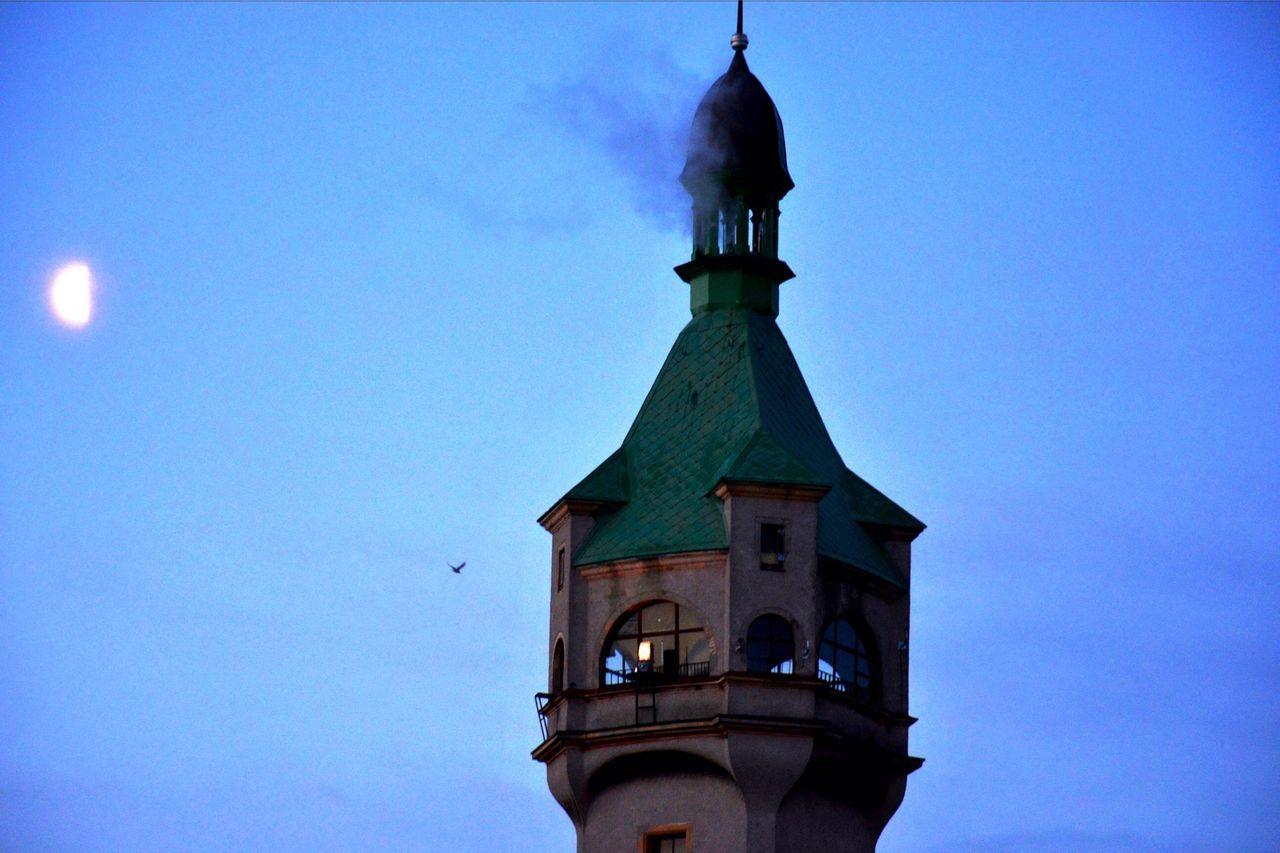 Lighthouse Against Moonlight Sky